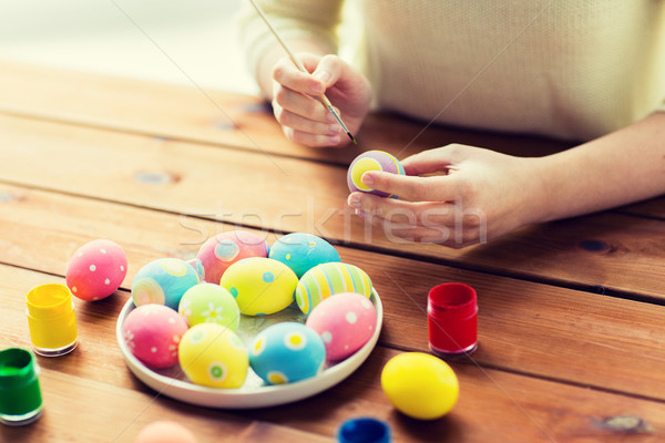 close up of woman hands coloring easter eggs stock photo ...