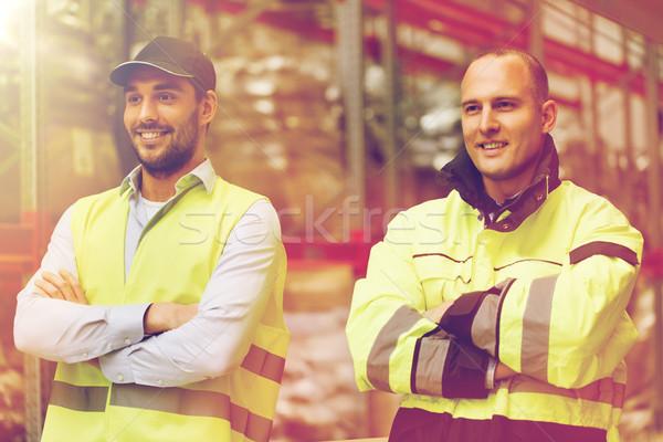 улыбаясь мужчин равномерный склад доставки Сток-фото © dolgachov