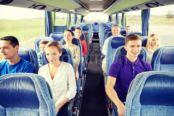 Grupo feliz pasajeros viaje autobús transporte Foto stock © dolgachov