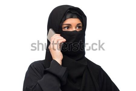Muslim donna hijab bianco tecnologia comunicazione Foto d'archivio © dolgachov