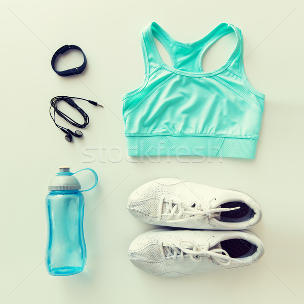 sportswear, bracelet, earphones and bottle set Stock photo © dolgachov