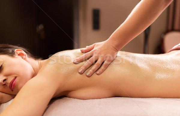 woman lying and having back massage at spa Stock photo © dolgachov