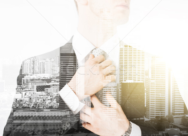 close up of man adjusting his tie Stock photo © dolgachov