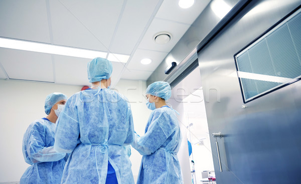 group of surgeons in operating room at hospital Stock photo © dolgachov