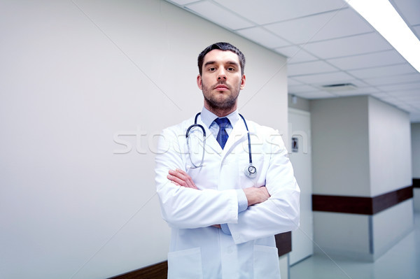 doctor with stethoscope at hospital corridor Stock photo © dolgachov