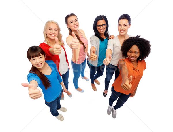 international group of women showing thumbs up Stock photo © dolgachov