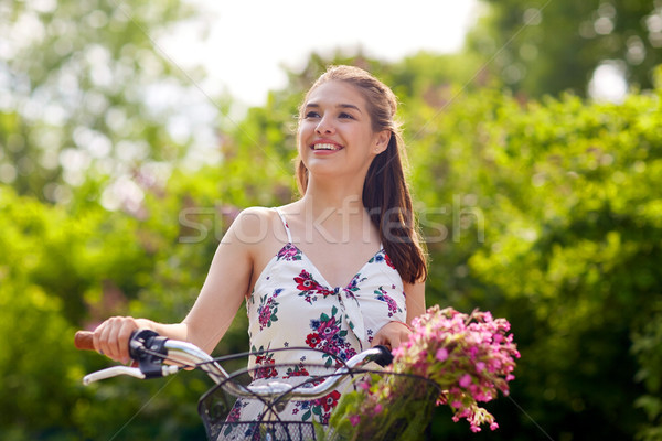 happy woman riding fixie bicycle in summer park Stock photo © dolgachov