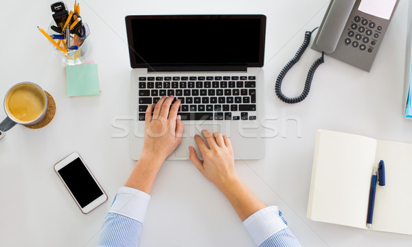 hands of businesswoman working on laptop at office Stock photo © dolgachov