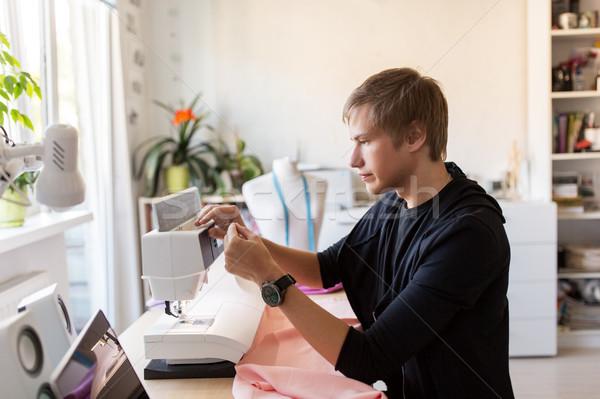 fashion designer with sewing machine at studio Stock photo © dolgachov