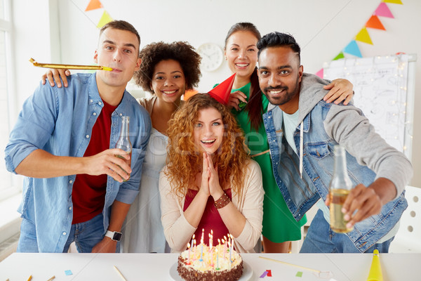 happy coworkers with cake at office birthday party Stock photo © dolgachov
