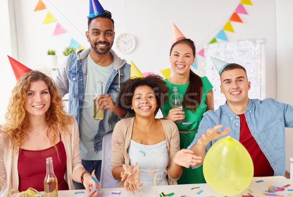 happy team having fun at office party Stock photo © dolgachov