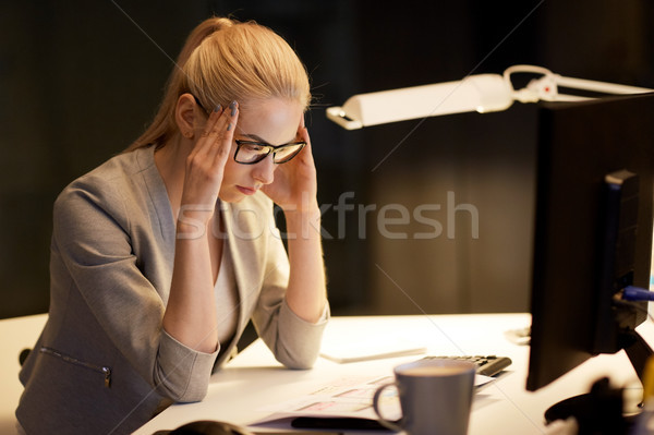 businesswoman at computer working at night office Stock photo © dolgachov