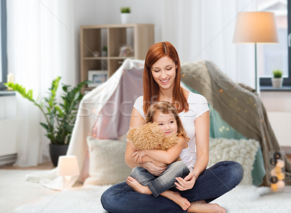 happy mother with adorable girl and teddy bear Stock photo © dolgachov
