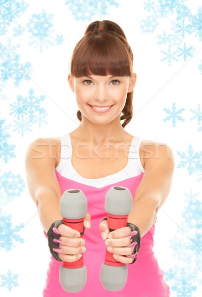 Fitness istruttore manubri bianco donna neve Foto d'archivio © dolgachov