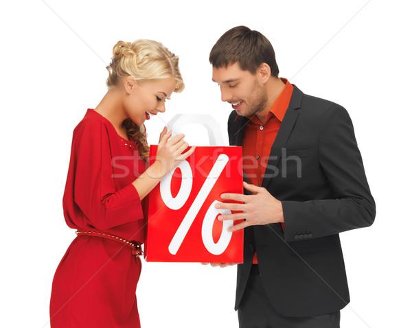 Hombre mujer bolsa de la compra brillante Foto nina Foto stock © dolgachov