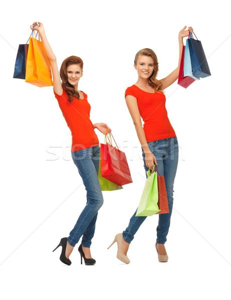two teenage girls with shopping bags Stock photo © dolgachov