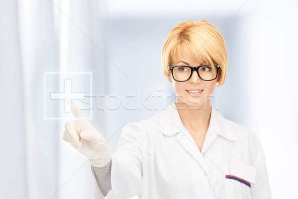 attractive female doctor Stock photo © dolgachov