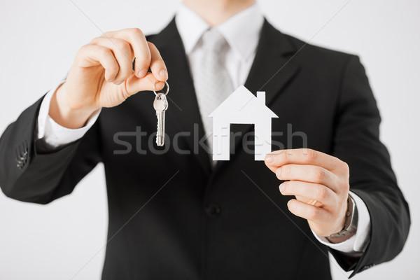 man holding house keys and paper house Stock photo © dolgachov