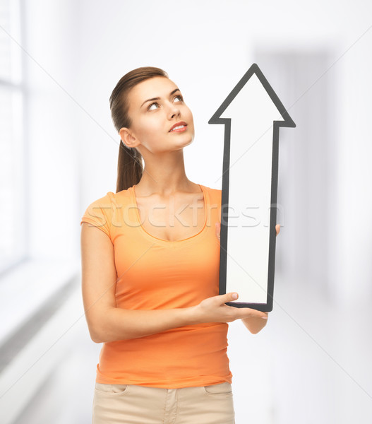 smiling woman with direction arrow sign Stock photo © dolgachov