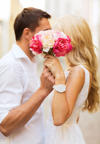 Stock photo: couple with flowers in the city