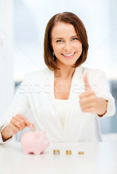 woman with piggy bank and cash money Stock photo © dolgachov