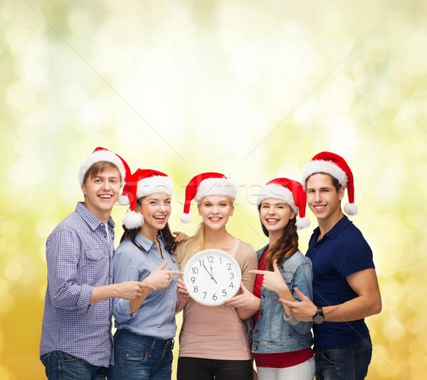 Csoport mosolyog diákok óra mutat 12 Stock fotó © dolgachov