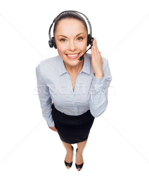 friendly female helpline operator with headphones Stock photo © dolgachov