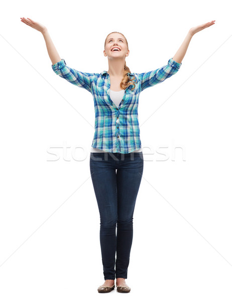 smiling young woman waving hands Stock photo © dolgachov
