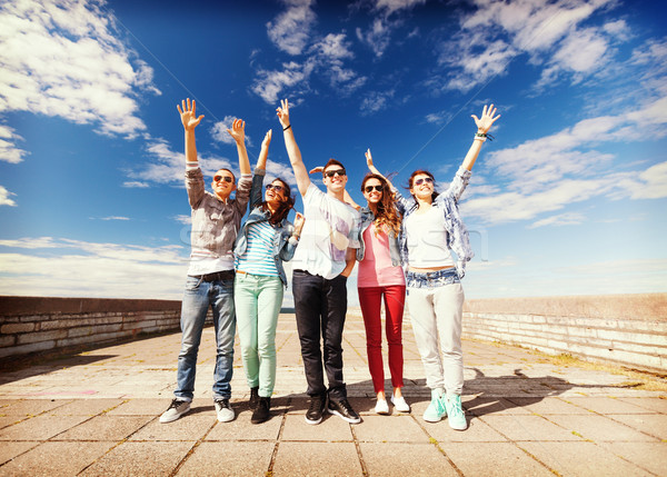 group of teenagers holding hands up Stock photo © dolgachov