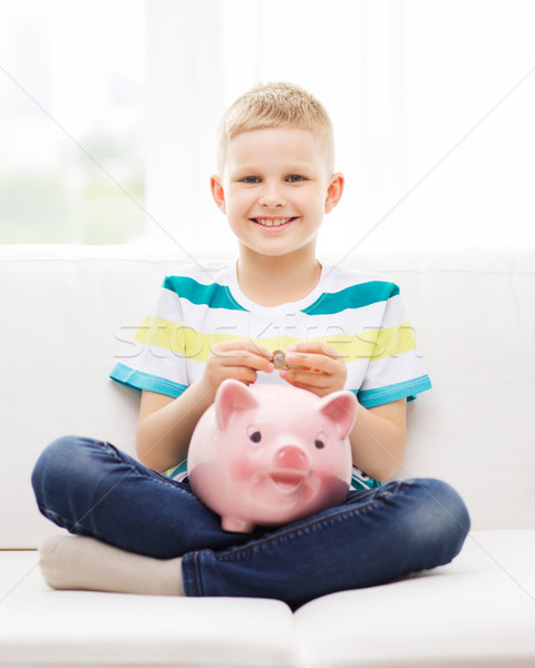 smiling little boy with piggy bank and money Stock photo © dolgachov