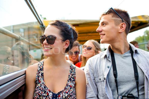 Mosolyog pár kamera utazó turné busz Stock fotó © dolgachov