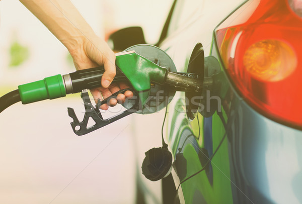 man pumping gasoline fuel in car at gas station Stock photo © dolgachov