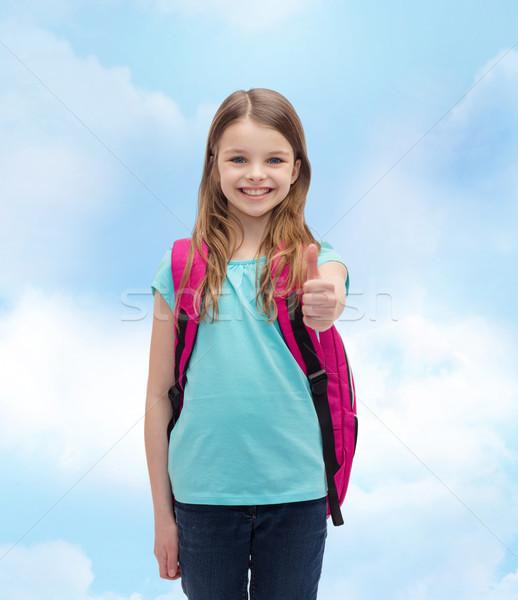 Mosolyog lány iskola táska mutat remek Stock fotó © dolgachov