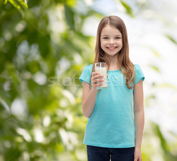 smiling little girl with glass of milk Stock photo © dolgachov