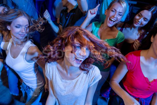 Stock fotó: Mosolyog · barátok · tánc · klub · buli · ünnepek