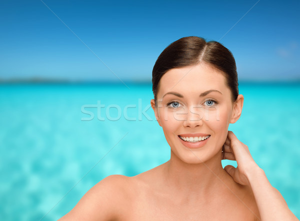 smiling young woman with bare shoulders Stock photo © dolgachov