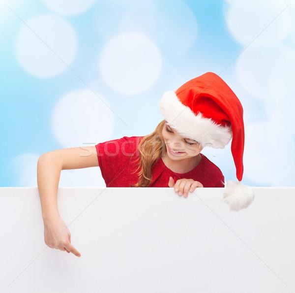 girl in santa helper hat with blank white board Stock photo © dolgachov