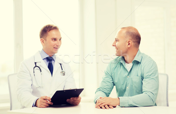 doctor with clipboard and patient in hospital Stock photo © dolgachov