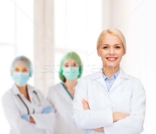 Uśmiechnięty kobiet lekarza grupy opieki zdrowotnej muzyka Zdjęcia stock © dolgachov