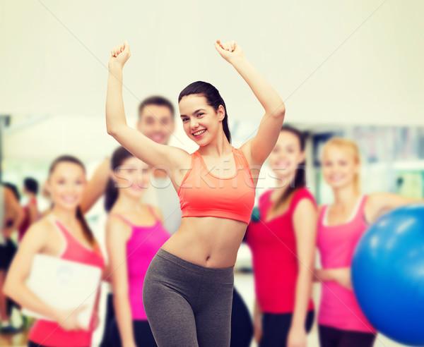 smiling teenage girl in sportswear dancing Stock photo © dolgachov