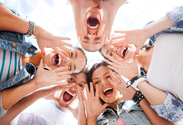 group of teenagers looking down and screaming Stock photo © dolgachov