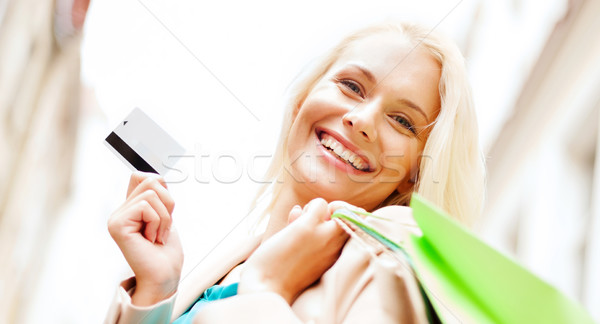 woman with shopping bags in ctiy Stock photo © dolgachov