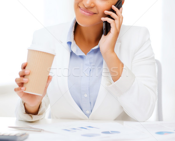 Stock photo: african businesswoman with smartphone in office