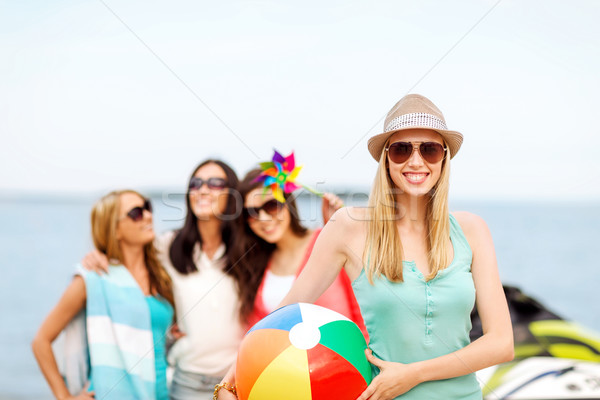 girl with ball and friends on the beach Stock photo © dolgachov