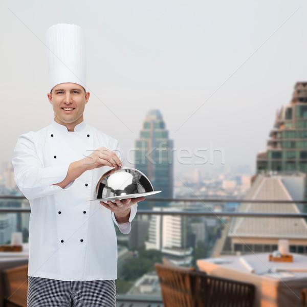happy male chef cook holding cloche Stock photo © dolgachov