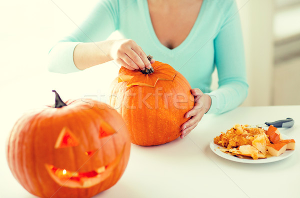 close up of woman with pumpkins at home Stock photo © dolgachov