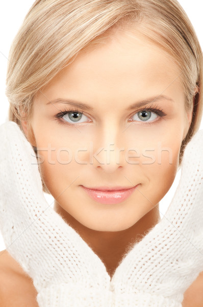 beautiful woman in white mittens Stock photo © dolgachov