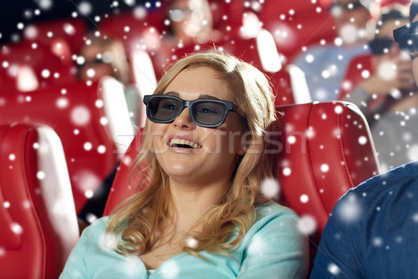 happy young woman watching 3d movie in theater Stock photo © dolgachov