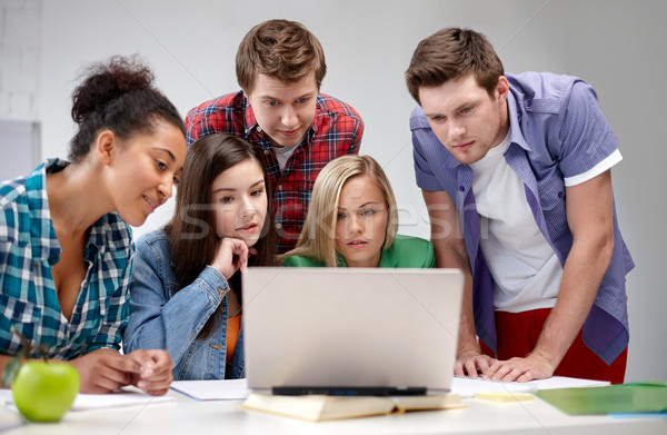 group of high school students with laptop Stock photo © dolgachov