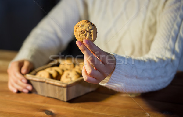 close up of woman with oat cookies at home Stock photo © dolgachov